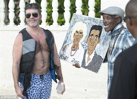 Simon Cowell with son Eric and partner Lauren Silverman on